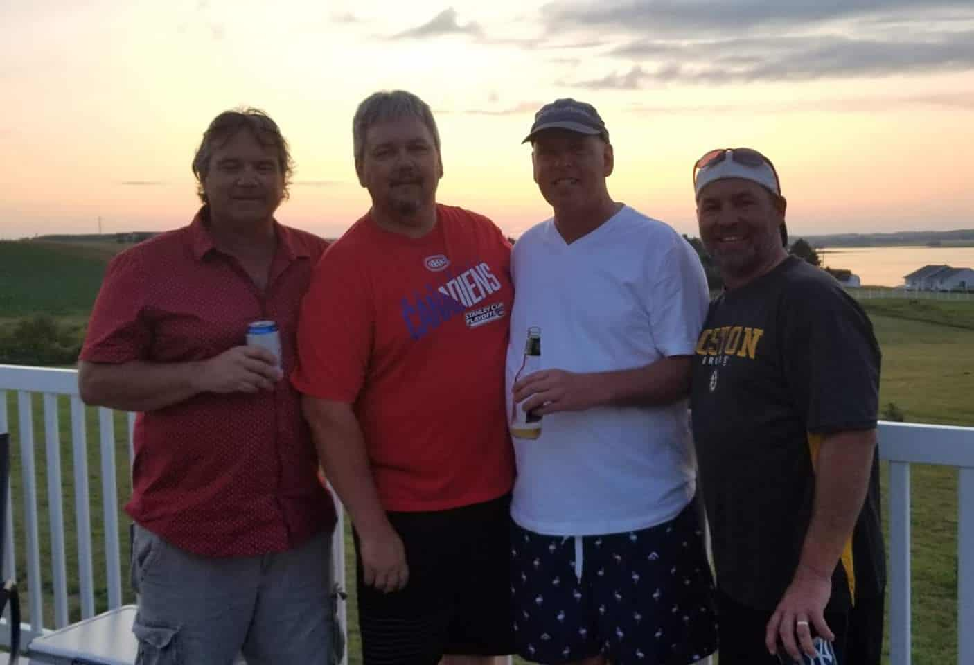 picture of guys on vacation, faces are too dark