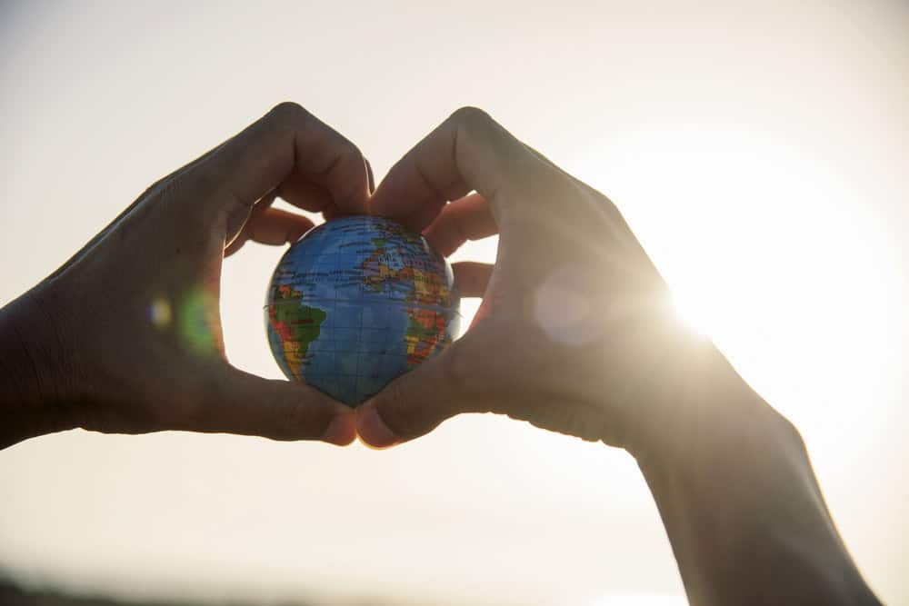 hands and the world - an image to depict climate change and tourism